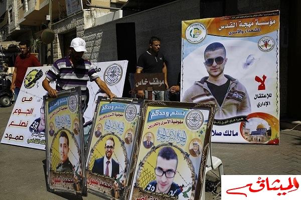 Iالأسرى الفلسطينيون ينتصرون يعلقون إضرابهم
